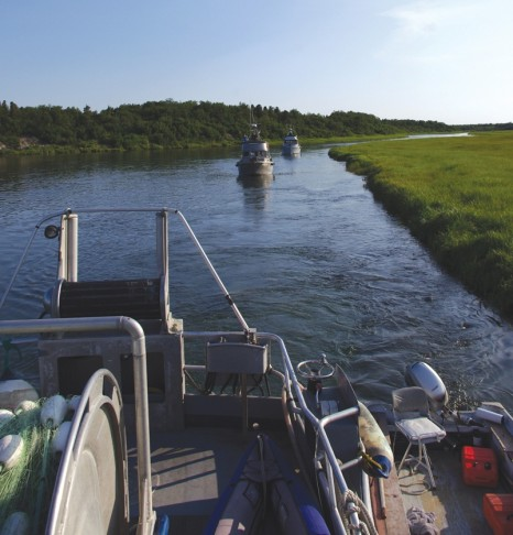 Homer-based drift gillnet boats the  through a braided stretch of the Kvichak River on June 17.