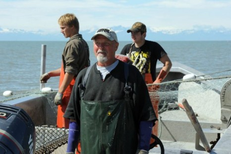 Ken Coleman, center, setnet fishes with sons Bailey, left, and Brandon on July 23, 2015
