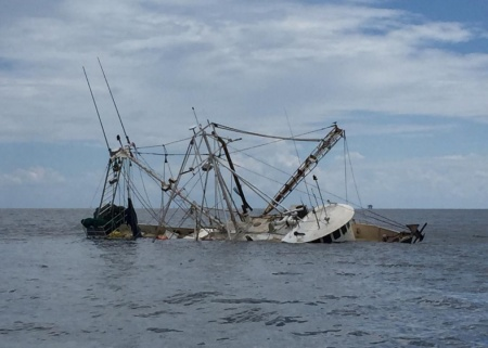 The fishing vessel Richie Rich is partially submerged 12 miles southwest of Point Au Fer in the Gulf of Mexico, Aug. 31, 2015