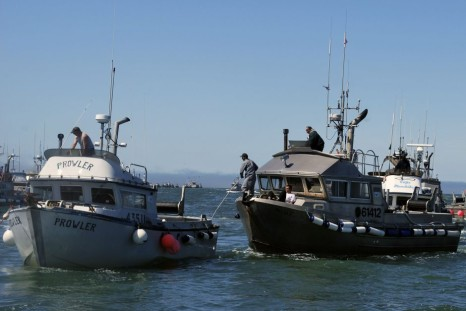 July 4, 2009 photo, drift gillnet fishing vessels line up near Egegik, Alaska,