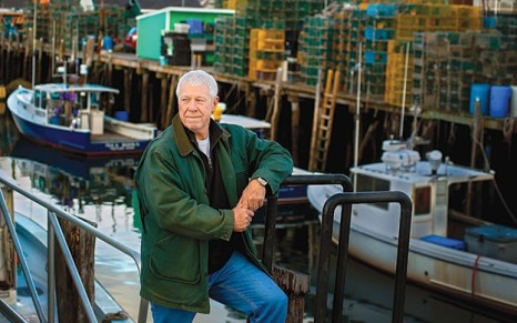 John Norton, president and co-founder of Cozy Harbor Seafood, outside the Portland waterfront facility.