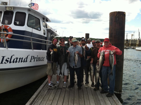 A crew of customers showing their catch from the Island Prince, Captain John's Charter's last year.