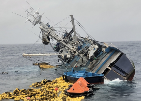 Coast Guard rescues 25 fishermen and 12 Coast Guardsmen as boarded vessel capsizes and sinks