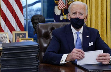 Biden signs executive orders on first day as president