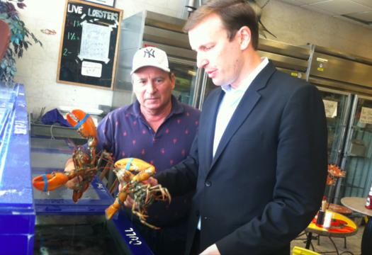U.S. Sen. Chris Murphy, D-Conn., and Roger Frate, owner of Darien Seafood Market